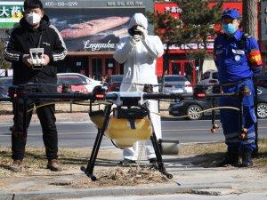 Çin'de salgınla mücadelede robotlar ve drone'lar sokağa çıktı