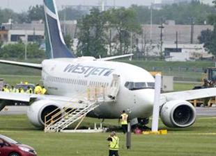 Yolcu uçağı acil iniş yaptı, inişte 6 yolcu yaralandı